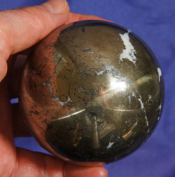 Energetic and Intense Pyrite Sphere with Calcite and Hematite Veins