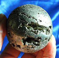 Surprisingly Energetic Pyrite Sphere with Crystal Caves