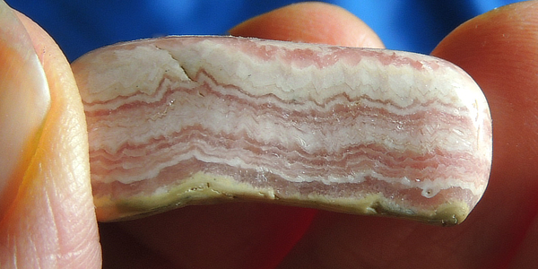 Banded Pocket-Sized Orange-Red Rhodochrosite Freeform