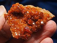 Vibrant Orange Vanadinite Crystals with Golden Fire